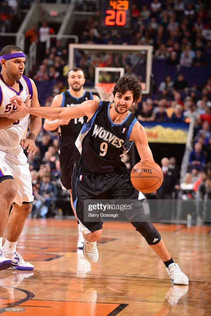 <a gi-track='captionPersonalityLinkClicked' href=/galleries/search?phrase=Ricky+Rubio&family=editorial&specificpeople=4028920 ng-click='$event.stopPropagation()'>Ricky Rubio</a> #9 of the Minnesota Timberwolves drives against <a gi-track='captionPersonalityLinkClicked' href=/galleries/search?phrase=Jared+Dudley&family=editorial&specificpeople=224071 ng-click='$event.stopPropagation()'>Jared Dudley</a> #3 of the Phoenix Suns on February 26, 2013 at U.S. Airways Center in Phoenix, Arizona.