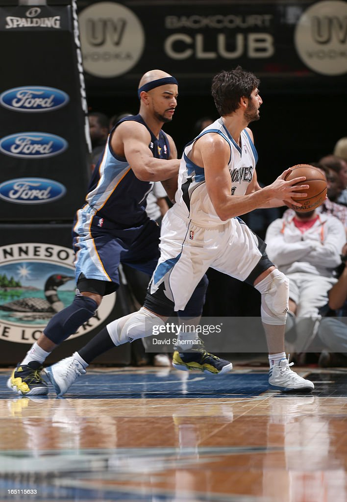 Ricky Rubio #9 of the Minnesota Timberwolves drives against Jerryd Bayless #7 of the Memphis Grizzlies during the game between the Memphis Grizzlies and the Minnesota Timberwolves on March 30, 2013 at Target Center in Minneapolis, Minnesota.