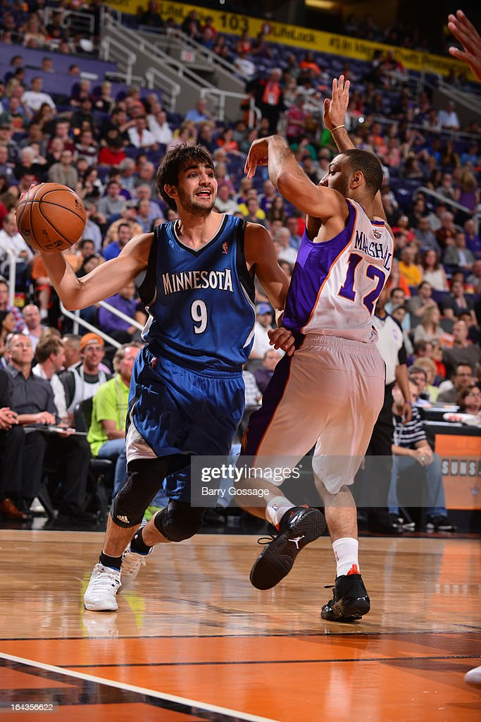 Ricky Rubio #9 of the Minnesota Timberwolves drives against Kendall Marshall #12 of the Phoenix Suns on March 22, 2013 at U.S. Airways Center in Phoenix, Arizona.