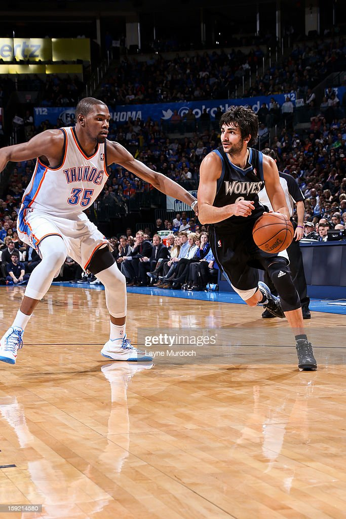 Ricky Rubio #9 of the Minnesota Timberwolves drives against Kevin Durant #35 of the Oklahoma City Thunder on January 9, 2013 at the Chesapeake Energy Arena in Oklahoma City, Oklahoma.
