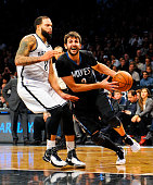 Ricky Rubio of the Minnesota Timberwolves drives around Deron Williams of the Brooklyn Nets in the second half at the Barclays Center on November 5...
