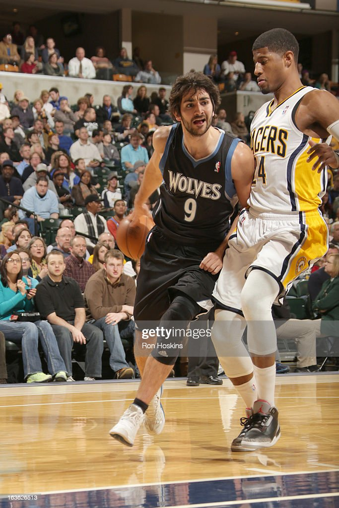 Ricky Rubio #9 of the Minnesota Timberwolves drives around Paul George #24 of the Indiana Pacers during the game between the Indiana Pacers and the Minnesota Timberwolves on March 13, 2013 at Bankers Life Fieldhouse in Indianapolis, Indiana.