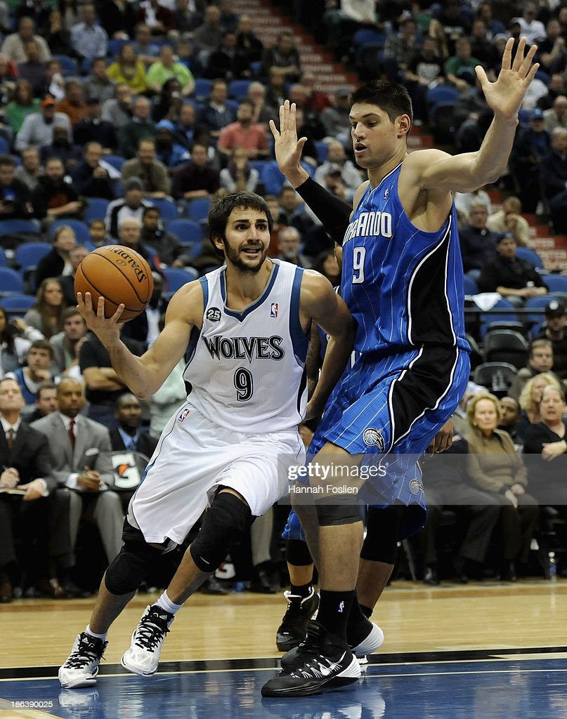 Ricky Rubio #9 of the Minnesota Timberwolves drives to the basket against Nikola Vucevic #9 of the Orlando Magic during overtime of the season opening game on October 30, 2013 at Target Center in Minneapolis, Minnesota. The Timberwolves defeated the Magic 120-115 in overtime.