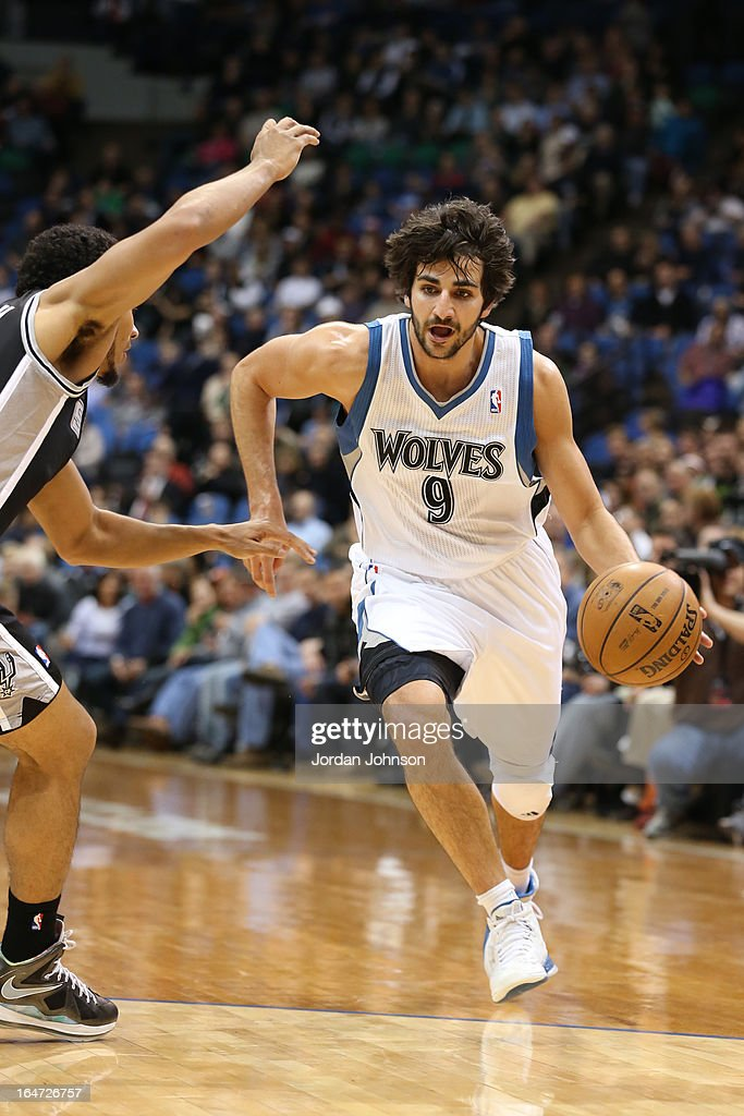 Ricky Rubio #9 of the Minnesota Timberwolves drives to the basket against the San Antonio Spurs on March 12, 2013 at Target Center in Minneapolis, Minnesota.