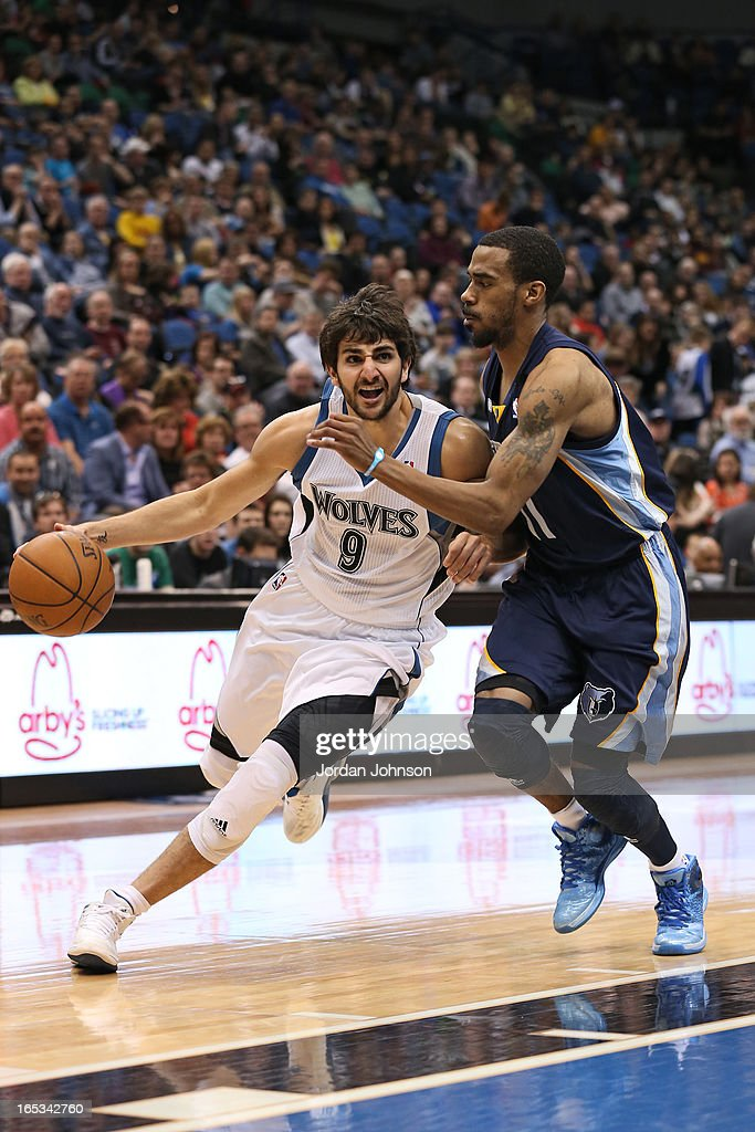 <a gi-track='captionPersonalityLinkClicked' href=/galleries/search?phrase=Ricky+Rubio&family=editorial&specificpeople=4028920 ng-click='$event.stopPropagation()'>Ricky Rubio</a> #9 of the Minnesota Timberwolves drives to the basket against the Memphis Grizzlies on March 30, 2013 at Target Center in Minneapolis, Minnesota.