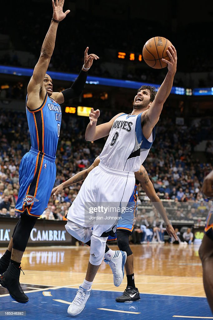<a gi-track='captionPersonalityLinkClicked' href=/galleries/search?phrase=Ricky+Rubio&family=editorial&specificpeople=4028920 ng-click='$event.stopPropagation()'>Ricky Rubio</a> #9 of the Minnesota Timberwolves drives to the basket against the Oklahoma City Thunder on March 29, 2013 at Target Center in Minneapolis, Minnesota.