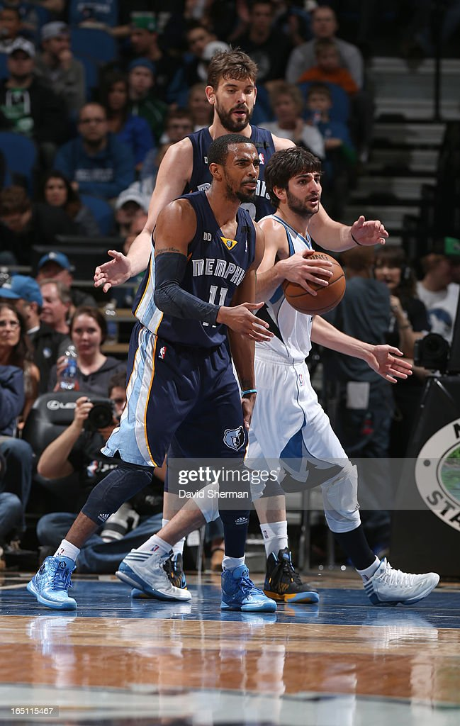 Ricky Rubio #9 of the Minnesota Timberwolves drives under pressure during the game between the Memphis Grizzlies and the Minnesota Timberwolves on March 30, 2013 at Target Center in Minneapolis, Minnesota.