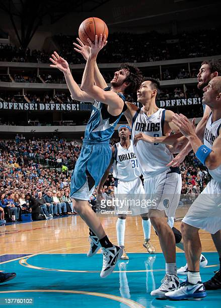 Ricky Rubio of the Minnesota Timberwolves goes in for the layup against Yi Jianlian of the Dallas Mavericks on January 25 2012 at the American...