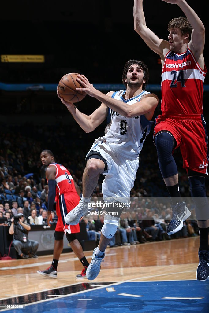 Ricky Rubio #9 of the Minnesota Timberwolves goes to the basket against Jan Vesely #24 of the Washington Wizards on March 6, 2013 at Target Center in Minneapolis, Minnesota.