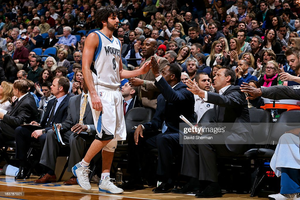 Ricky Rubio #9 of the Minnesota Timberwolves greets assistant head coaches on his way to the bench during a game against the San Antonio Spurs on March 12, 2013 at Target Center in Minneapolis, Minnesota.