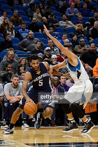 Ricky Rubio of the Minnesota Timberwolves guards against Andrew Harrison of the Memphis Grizzlies during the preseason game on October 19 2016 at...