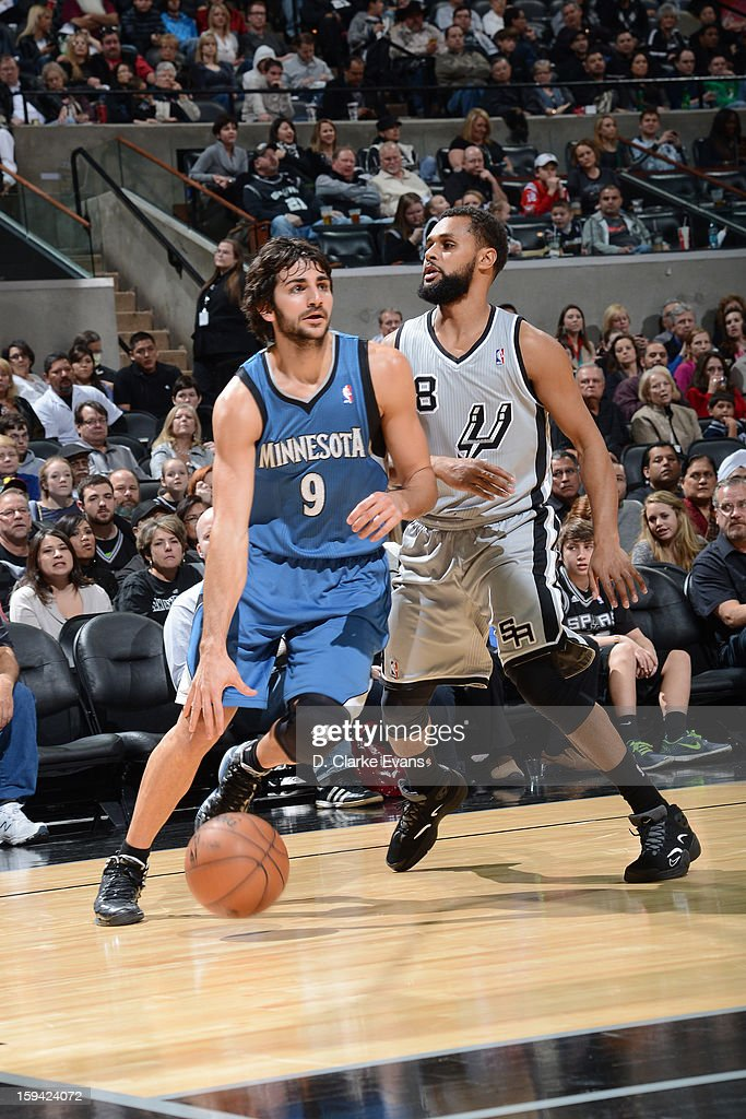 Ricky Rubio #9 of the Minnesota Timberwolves handles the ball against Patty Mills #8 of the San Antonio Spurs on January 13, 2013 at the AT&T Center in San Antonio, Texas.