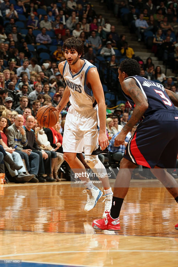 Ricky Rubio #9 of the Minnesota Timberwolves handles the ball against Louis Williams #3 of the Atlanta Hawks on January 8, 2013 at Target Center in Minneapolis, Minnesota.