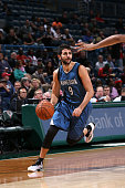 Ricky Rubio of the Minnesota Timberwolves handles the ball against the Milwaukee Bucks during the game on October 22 2014 at the BMO Harris Bradley...