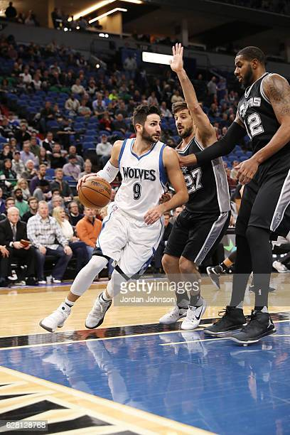 Ricky Rubio of the Minnesota Timberwolves handles the ball against Nicolas Laprovittola of the San Antonio Spurs during the game on December 6 2016...