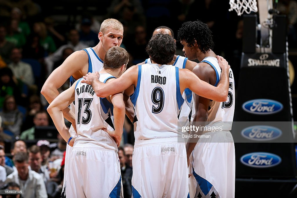 Ricky Rubio #9 of the Minnesota Timberwolves huddles up with teammates, from left, Greg Stiemsma #34, Luke Ridnour #13, Derrick Williams #7 and Mickael Gelabale #15 during a game against the New Orleans Hornets on March 17, 2013 at Target Center in Minneapolis, Minnesota.