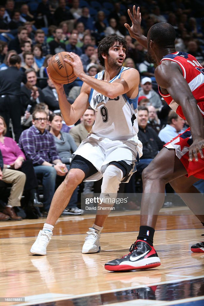 Ricky Rubio #9 of the Minnesota Timberwolves looks to pass the ball against Emeka Okafor #50 of the Washington Wizards on March 6, 2013 at Target Center in Minneapolis, Minnesota.