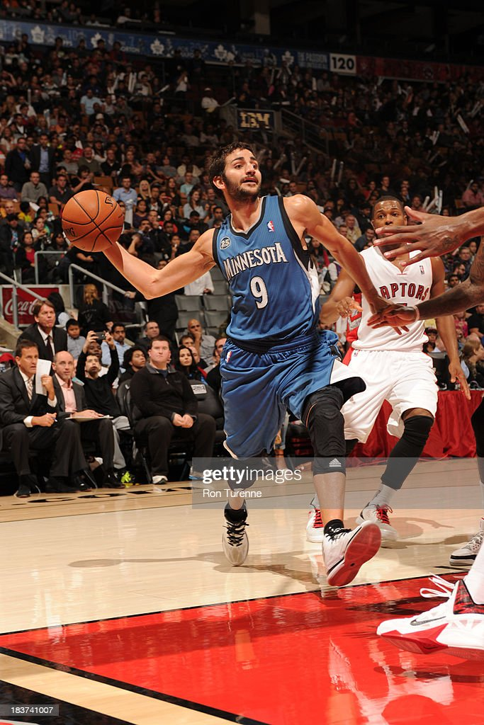 <a gi-track='captionPersonalityLinkClicked' href=/galleries/search?phrase=Ricky+Rubio&family=editorial&specificpeople=4028920 ng-click='$event.stopPropagation()'>Ricky Rubio</a> #9 of the Minnesota Timberwolves passes the ball against the Toronto Raptors during the game on October 9, 2013 at the Air Canada Centre in Toronto, Ontario, Canada.