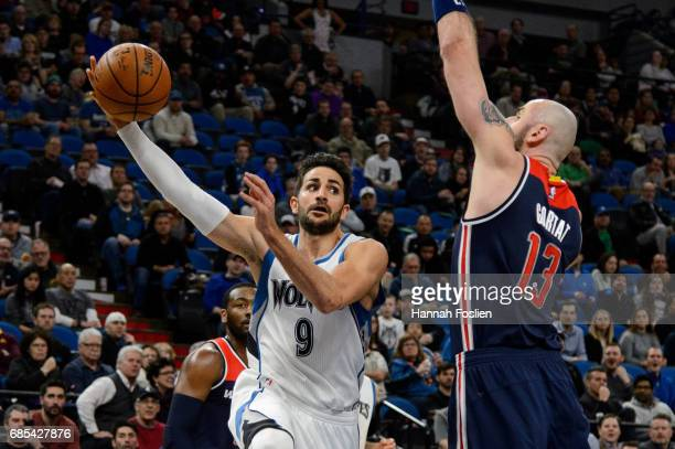 Ricky Rubio of the Minnesota Timberwolves passes the ball away from Marcin Gortat of the Washington Wizards during the first quarter of the game on...