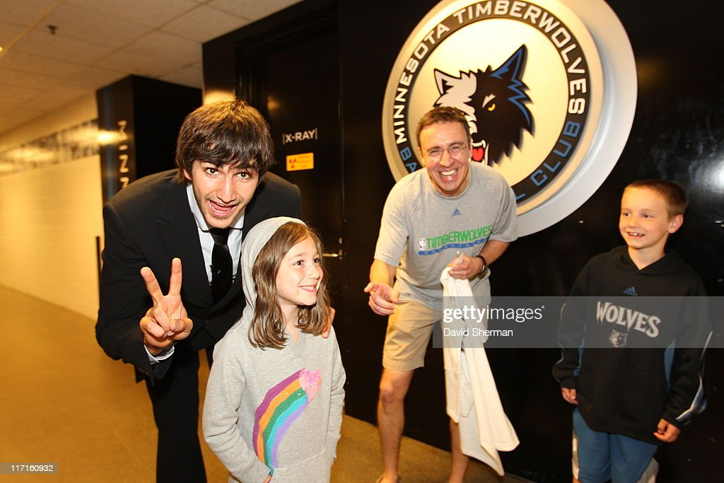 <a gi-track='captionPersonalityLinkClicked' href=/galleries/search?phrase=Ricky+Rubio&family=editorial&specificpeople=4028920 ng-click='$event.stopPropagation()'>Ricky Rubio</a> of the Minnesota Timberwolves poses with fans at the team's 2011 NBA Draft Party at Target Center on June 23, 2011 in Minneapolis, Minnesota.