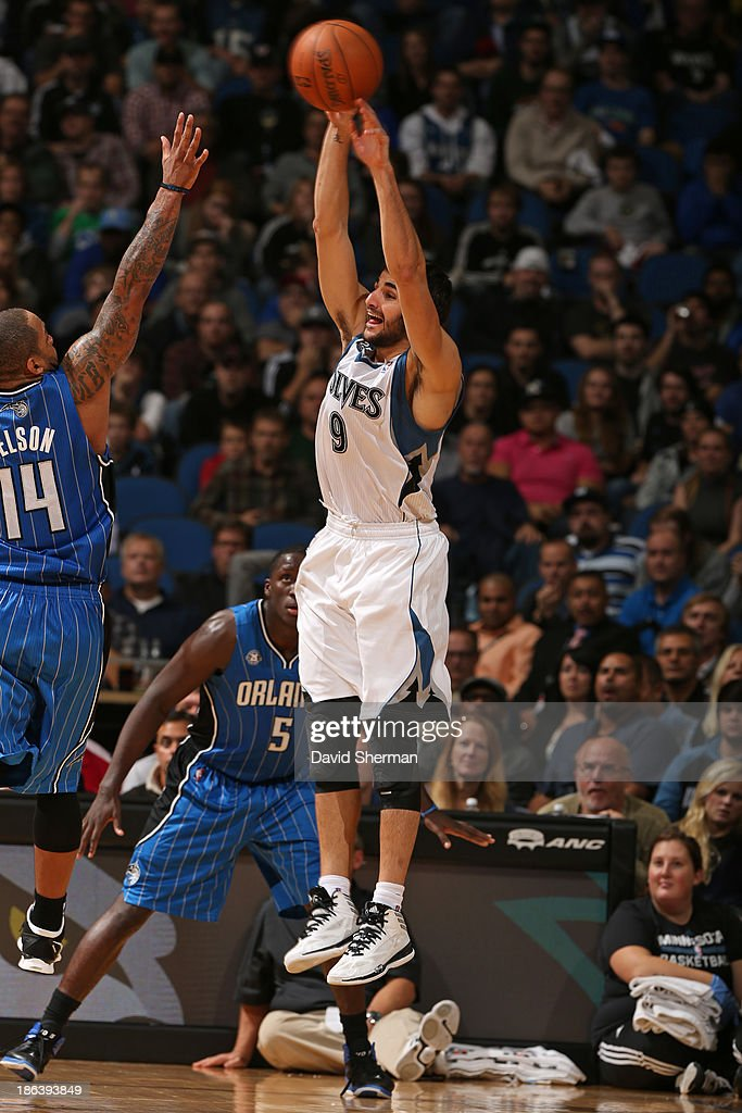 <a gi-track='captionPersonalityLinkClicked' href=/galleries/search?phrase=Ricky+Rubio&family=editorial&specificpeople=4028920 ng-click='$event.stopPropagation()'>Ricky Rubio</a> #9 of the Minnesota Timberwolves shoots the ball against the Orlando Magic during the season and home opening game on October 30, 2013 at Target Center in Minneapolis, Minnesota.