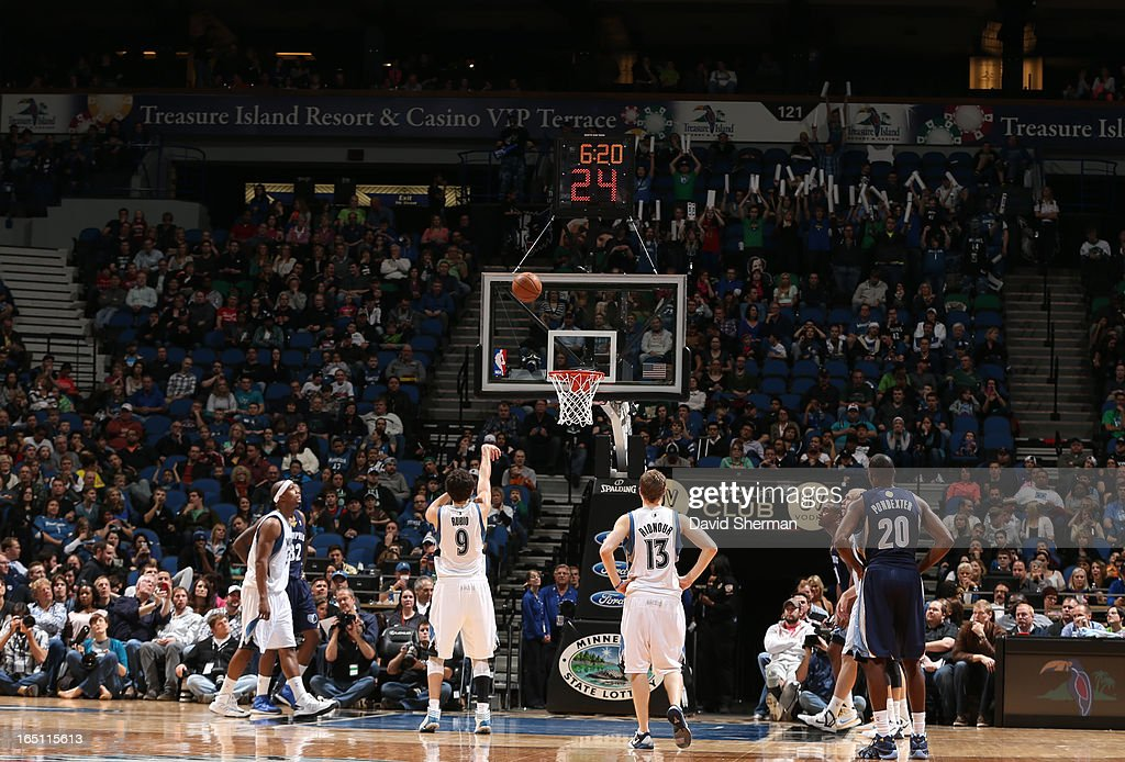 Ricky Rubio #9 of the Minnesota Timberwolves shoots the ball during the game between the Memphis Grizzlies and the Minnesota Timberwolves on March 30, 2013 at Target Center in Minneapolis, Minnesota.