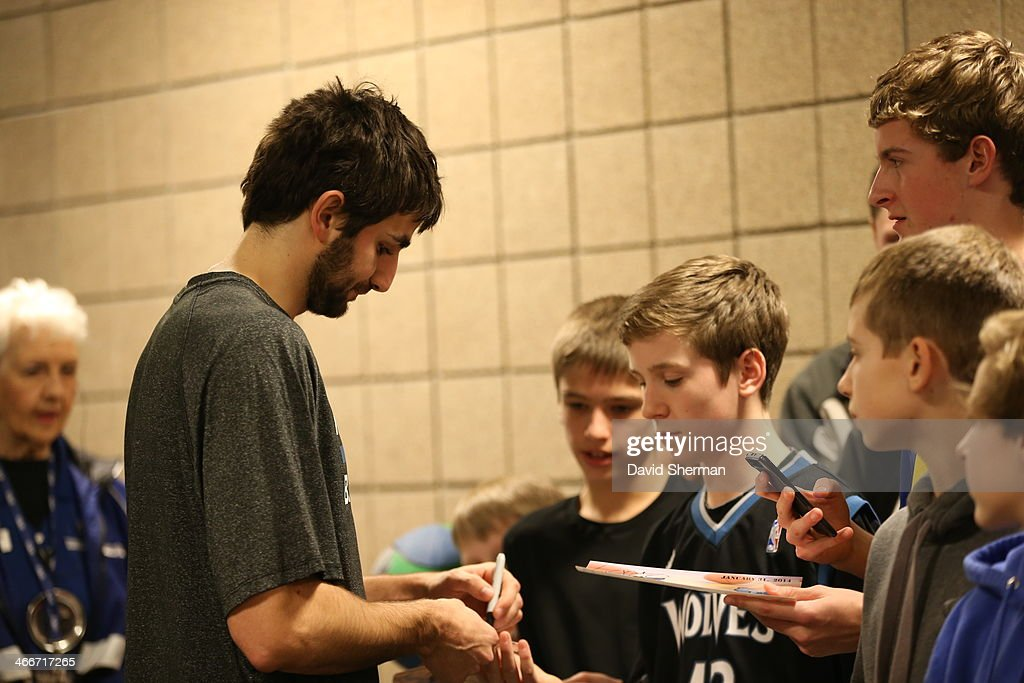Ricky Rubio of the Minnesota Timberwolves signs autograph after the game against the Memphis Grizzlies on January 31 2014 at Target Center in...