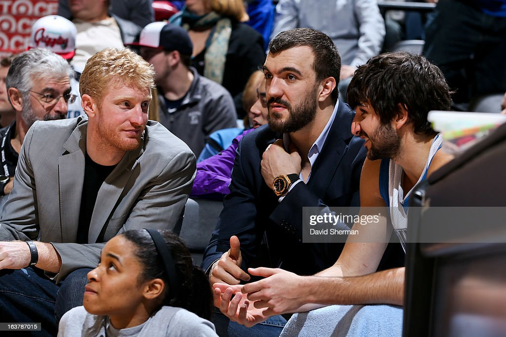 Ricky Rubio #9 of the Minnesota Timberwolves speaks to teammates Chase Budinger #10 and Nikola Pekovic #14 on the bench during a game against the San Antonio Spurs on March 12, 2013 at Target Center in Minneapolis, Minnesota.