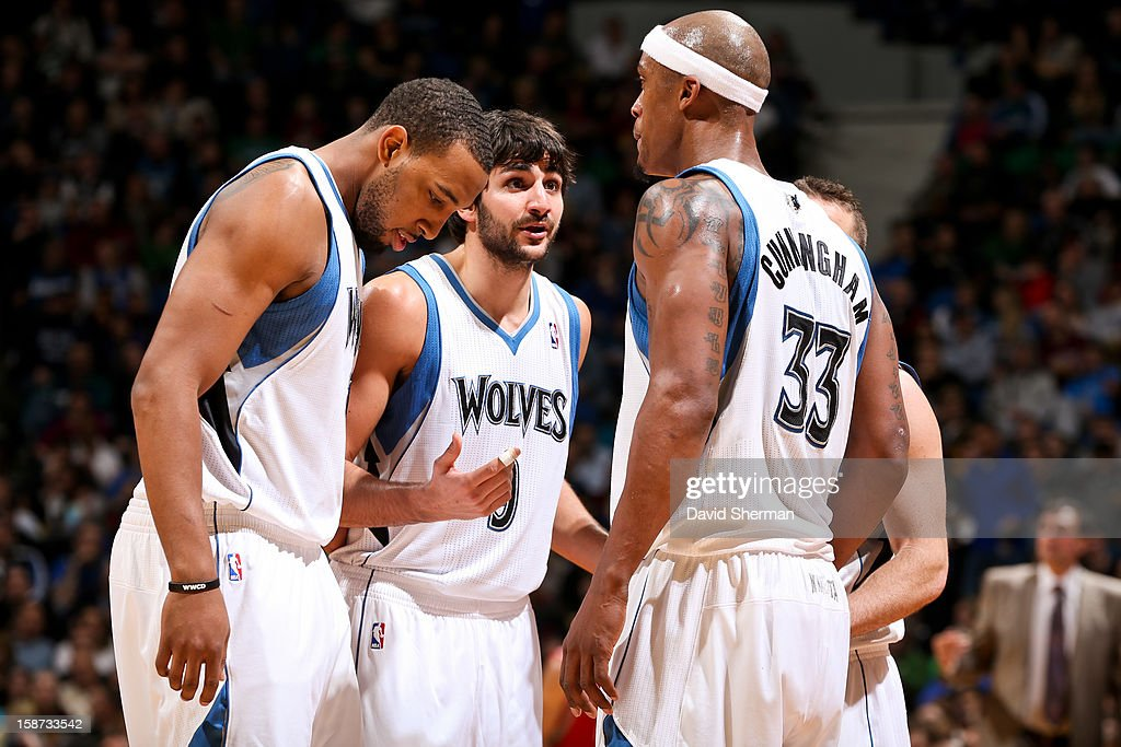 Ricky Rubio #9 of the Minnesota Timberwolves speaks to teammates Derrick Williams #7 and Dante Cunningham #33 before resuming action against the Houston Rockets on December 26, 2012 at Target Center in Minneapolis, Minnesota.