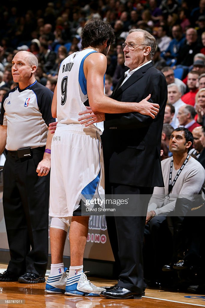 Ricky Rubio #9 of the Minnesota Timberwolves speaks with head coach Rick Adelman during a game against the San Antonio Spurs on March 12, 2013 at Target Center in Minneapolis, Minnesota.