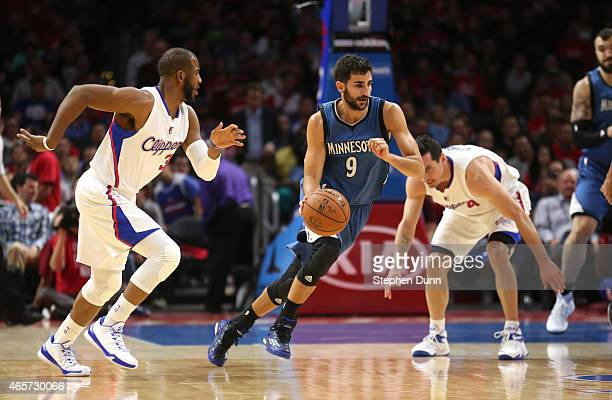 Ricky Rubio of the Minnesota Timberwolves starts a fast break against Chris Paul of the Los Angeles Clippers at Staples Center on March 9 2015 in Los...