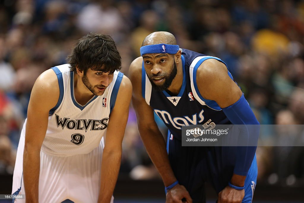 Ricky Rubio #9 of the Minnesota Timberwolves talks to Vince Carter #25 of the Dallas Mavericks during the game on March 10, 2013 at Target Center in Minneapolis, Minnesota.