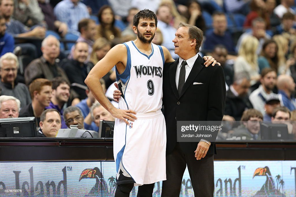 Ricky Rubio of the Minnesota Timberwolves talks with Head Coach Flip Saunders during the game against the Indiana Pacers on October 21 2014 at Target...