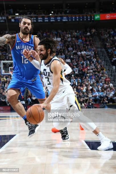 Ricky Rubio of the Utah Jazz handles the ball against Steven Adams of the Oklahoma City Thunder on October 21 2017 at vivintSmartHome Arena in Salt...
