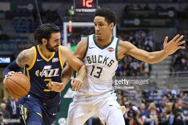 Ricky Rubio of the Utah Jazz is defended by Malcolm Brogdon of the Milwaukee Bucks during a game at the Bradley Center on December 9 2017 in...