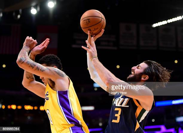 Ricky Rubio of the Utah Jazz shoots after he is bumped by Kyle Kuzma of the Los Angeles Lakers during a 10599 Jazz win at Staples Center on October...