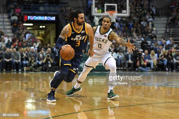 Ricky Rubio of the Utah Jazz works against Gary Payton II of the Milwaukee Bucks during a game at the Bradley Center on December 9 2017 in Milwaukee...
