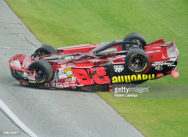 Ricky Rudd driving the Yates Racing Texaco Havoline Ford Taurus crashes and overturns following a collision with Sterling Marlin on the final lap of...