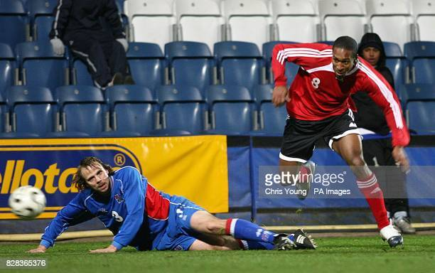Ricky Shakes of Trinidad skips past Indridi Sigurdsson during the International Friendly match between Iceland and Trinidad and Tobago at Loftus Road...