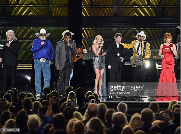 Ricky Skaggs Charlie Daniels Charley Pride Carrie Underwoiod Randy Travis Brad Paisley and Reba McEntire perform during the 50th annual CMA Awards at...