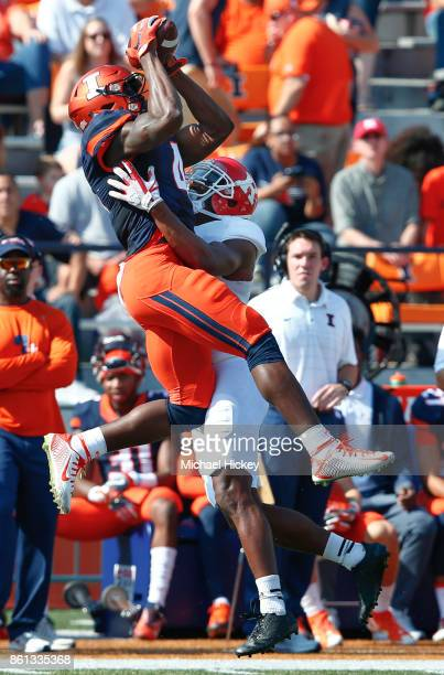 Ricky Smalling of the Illinois Fighting Illini goes up for a catch as Damon Hayes of the Rutgers Scarlet Knights defends at Memorial Stadium on...