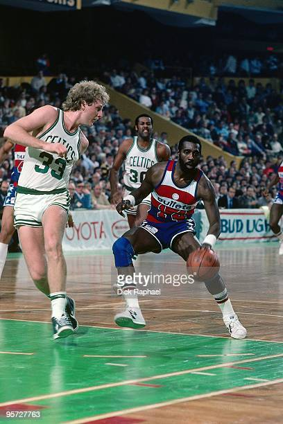Ricky Sobers of the Washington Bullets makes a move to the baket against Larry Bird of the Boston Celtics during a game played in 1984 at the Boston...