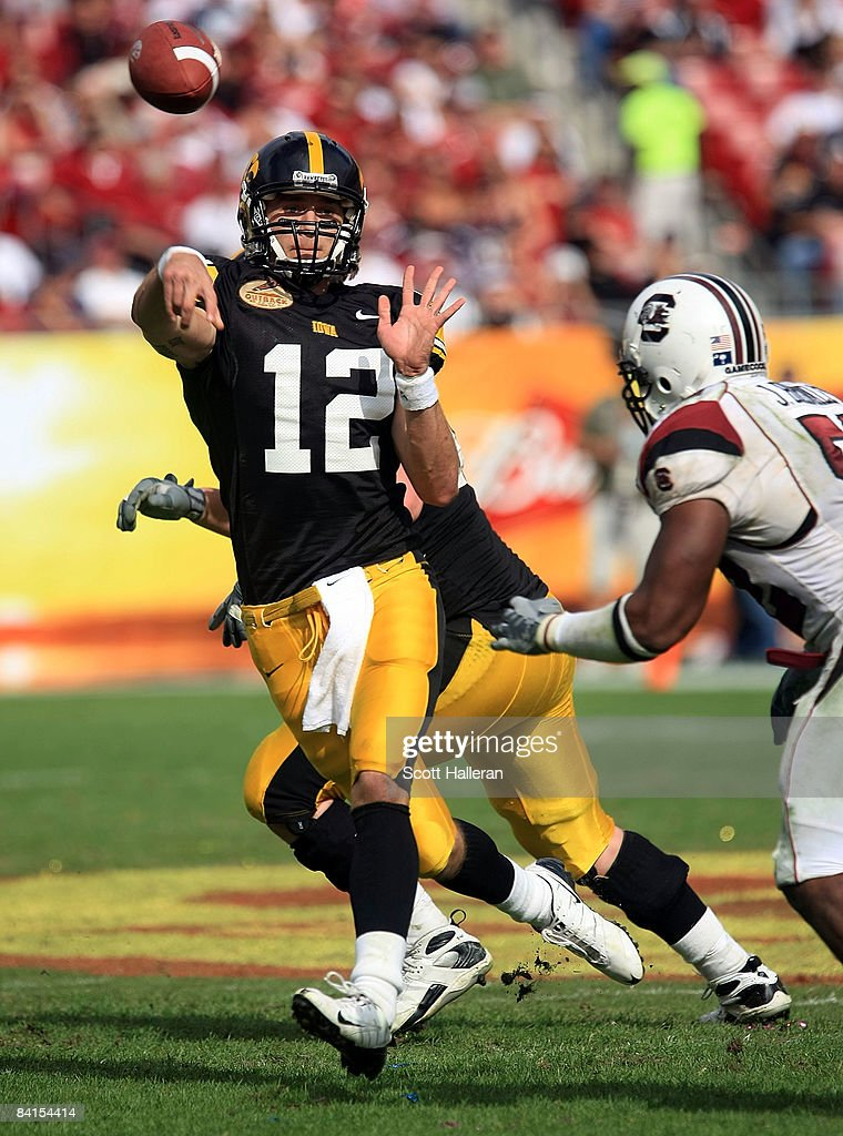 Ricky Stanzi of the Iowa Hawkeyes drops back to pass against the South Carolina Gamecocks during the Outback Bowl on January 1 2009 at Raymond James...
