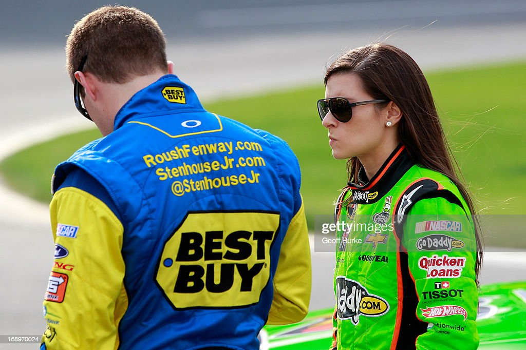 <a gi-track='captionPersonalityLinkClicked' href=/galleries/search?phrase=Ricky+Stenhouse+Jr.&family=editorial&specificpeople=5380612 ng-click='$event.stopPropagation()'>Ricky Stenhouse Jr.</a>, driver of the #17 Best Buy Ford, and <a gi-track='captionPersonalityLinkClicked' href=/galleries/search?phrase=Danica+Patrick&family=editorial&specificpeople=183352 ng-click='$event.stopPropagation()'>Danica Patrick</a>, driver of the #10 GoDaddy Chevrolet, stands on pit road during qualifying for the NASCAR Sprint Cup Series Showdown at Charlotte Motor Speedway on May 17, 2013 in Concord, North Carolina.