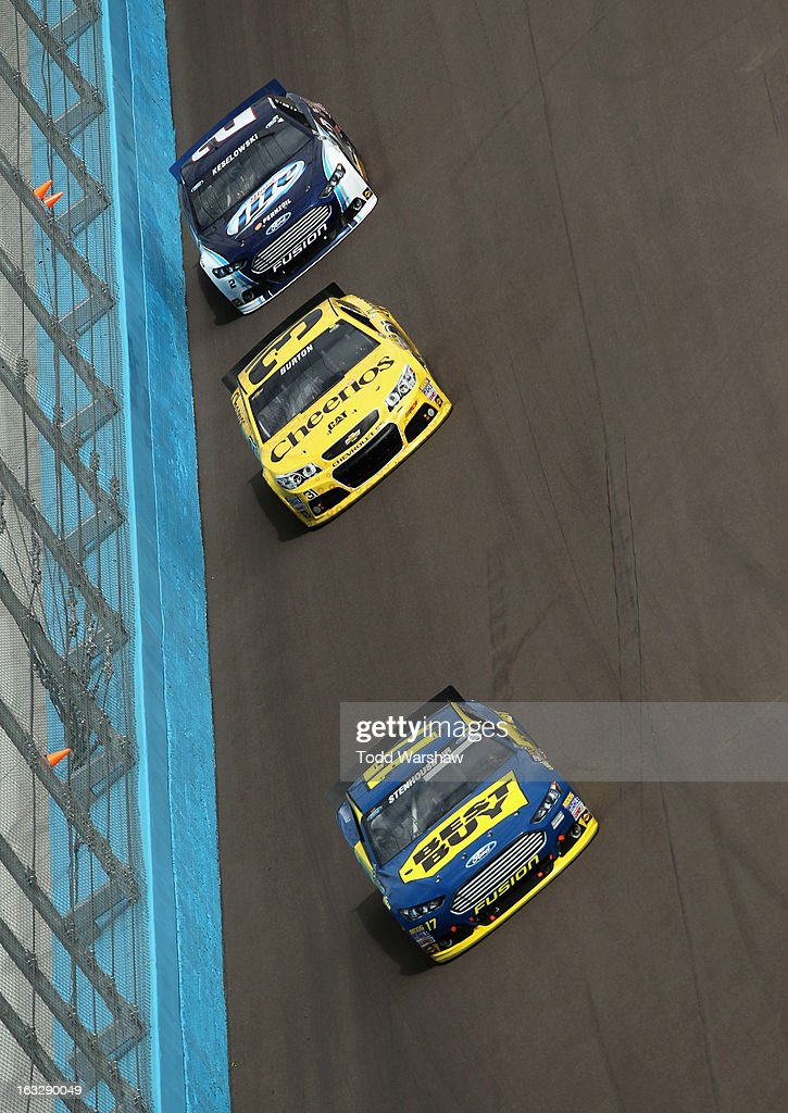 Ricky Stenhouse Jr driver of the Best Buy Ford Jeff Burton driver of the Cheerios Chevrolet and Brad Keselowski driver of the Miller Lite Ford race...