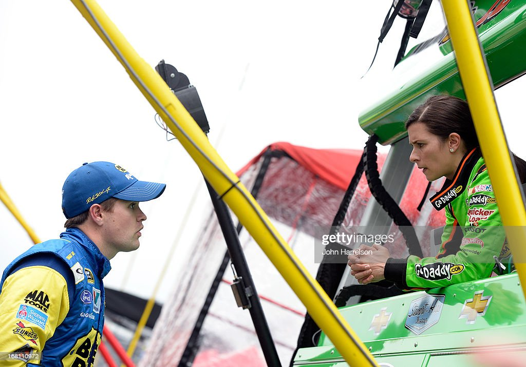 Ricky Stenhouse Jr., driver of the #17 Best Buy Ford, speaks with Danica Patrick, driver of the #10 GoDaddy.com Chevrolet, during a rain delay at the NASCAR Sprint Cup Series Aaron's 499 at Talladega Superspeedway on May 5, 2013 in Talladega, Alabama.