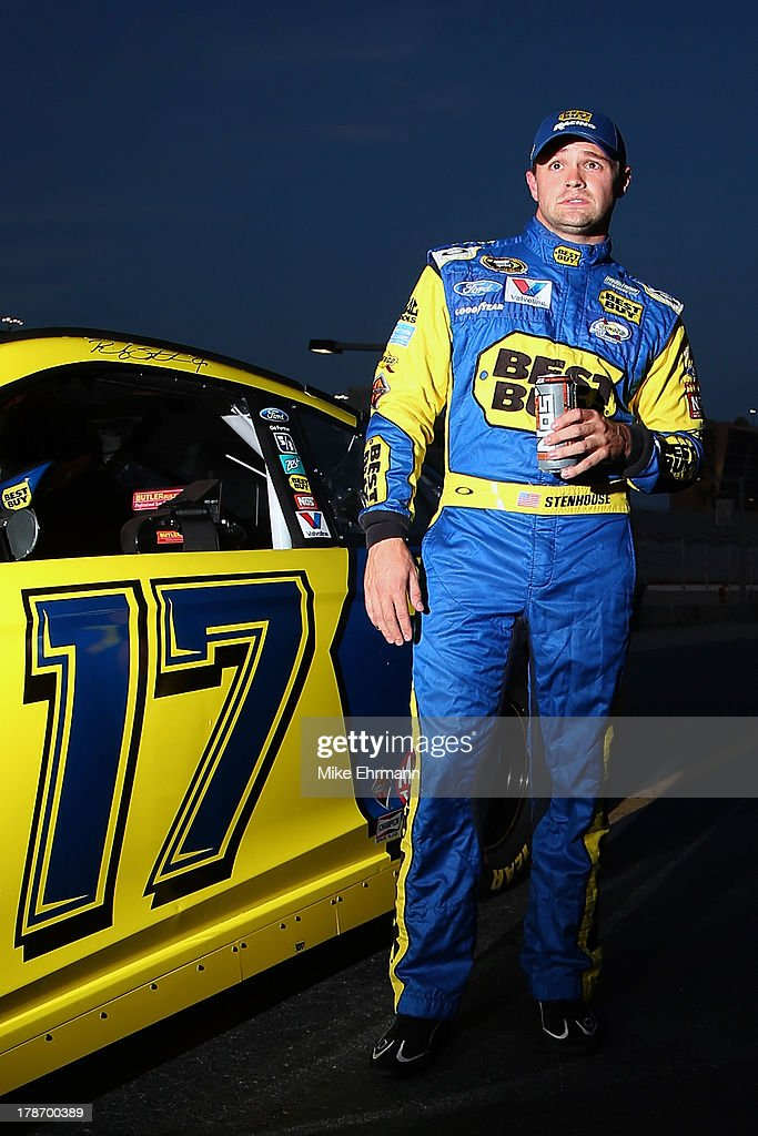 <a gi-track='captionPersonalityLinkClicked' href=/galleries/search?phrase=Ricky+Stenhouse+Jr.&family=editorial&specificpeople=5380612 ng-click='$event.stopPropagation()'>Ricky Stenhouse Jr.</a>, driver of the #17 Best Buy Ford, stands on the grstands on the gridduring qualifying for the NASCAR Sprint Cup Series AdvoCare 500 at Atlanta Motor Speedway on August 30, 2013 in Hampton, Georgia.