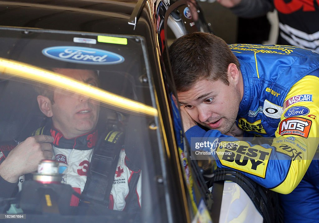 <a gi-track='captionPersonalityLinkClicked' href=/galleries/search?phrase=Ricky+Stenhouse+Jr.&family=editorial&specificpeople=5380612 ng-click='$event.stopPropagation()'>Ricky Stenhouse Jr.</a>, driver of the #17 Best Buy Ford, talks with <a gi-track='captionPersonalityLinkClicked' href=/galleries/search?phrase=Greg+Biffle&family=editorial&specificpeople=209093 ng-click='$event.stopPropagation()'>Greg Biffle</a>, driver of the #16 3M/Novec Ford, in the garage during practice for the NASCAR Sprint Cup Series Fresh Fit 500 at Phoenix International Raceway on March 2, 2013 in Avondale, Arizona.