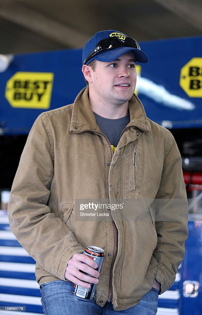 Ricky Stenhouse Jr., driver of the #17 Best Buy, stands in the garage during NASCAR Testing at Charlotte Motor Speedway on January 18, 2013 in Charlotte, North Carolina.