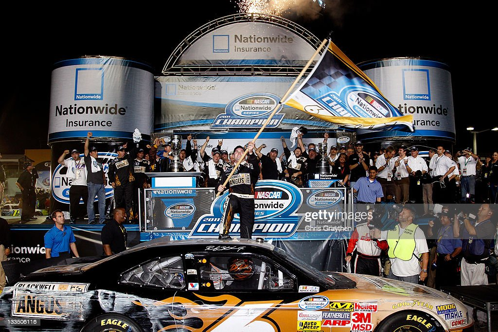 <a gi-track='captionPersonalityLinkClicked' href=/galleries/search?phrase=Ricky+Stenhouse+Jr.&family=editorial&specificpeople=5380612 ng-click='$event.stopPropagation()'>Ricky Stenhouse Jr.</a>, driver of the #6 Blackwell Angus Beef Ford, celebrates in Victory Lane after winning the 2011 Series Championship after the NASCAR Nationwide Series Ford 300 at Homestead-Miami Speedway on November 19, 2011 in Homestead, Florida.